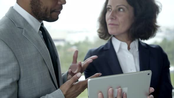 Thumbnail for Confident Business People Holding Tablet and Talking