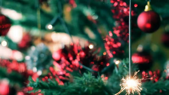 Thumbnail for Christmas tree with color balls and burning sparkler