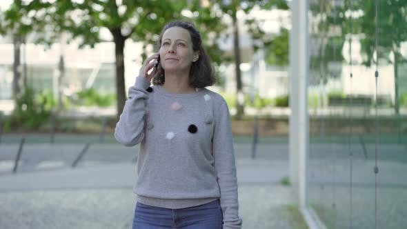Thumbnail for Happy Woman Talking on Phone Outdoor