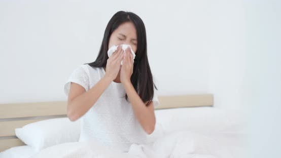 Thumbnail for Woman sneeze on bed
