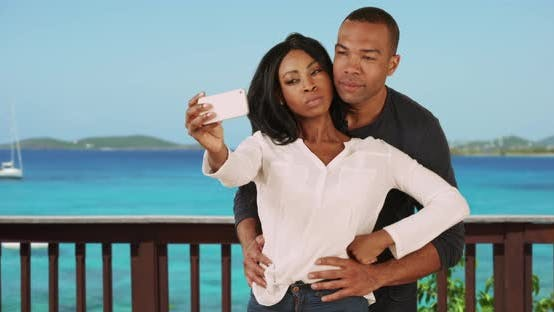 Thumbnail for Black couple on vacation in Caribbean taking selfie together