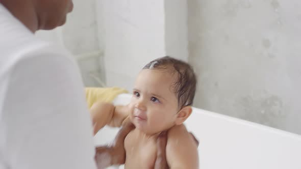 Cover Image for Indian Father Bonding with Toddler Girl during Bath Time