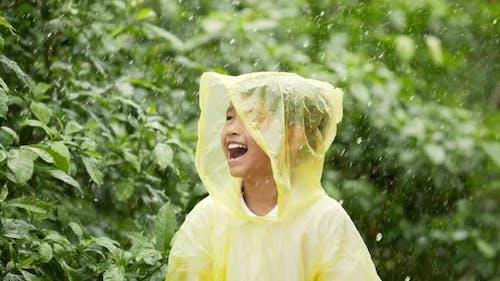 Happy boy wears raincoat