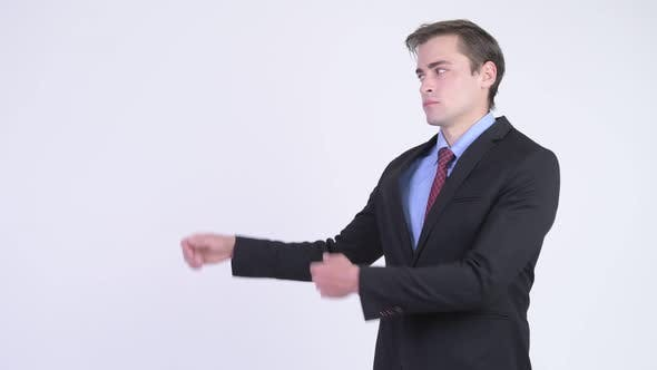 Thumbnail for Young Happy Handsome Businessman Showing Something