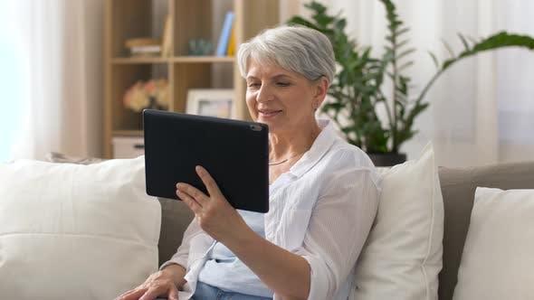 Thumbnail for Senior Woman Having Video Chat on Tablet Pc