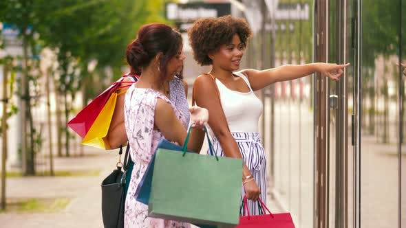 Thumbnail for Women with Shopping Bags Looking at Shop Window 58