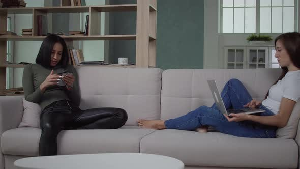 Thumbnail for Women Using Their Gadgets On Couch
