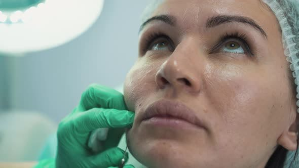Doctor Injects Anti-aging Filling To Woman in Beauty Clinic