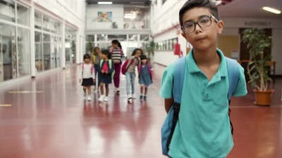 Funny Boy in Eyeglasses Going to Class Reluctantly