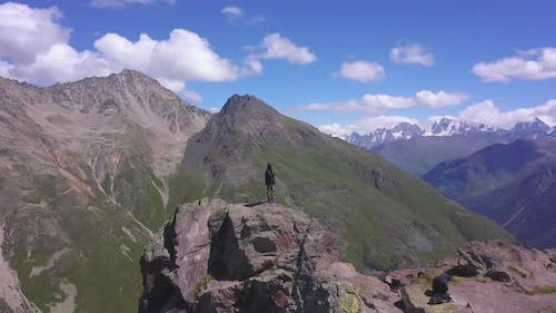Man is standing on top of the mountain