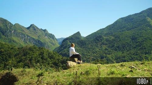 Woman Walking on Top of a Mountain Range to Enjoy Beautiful View