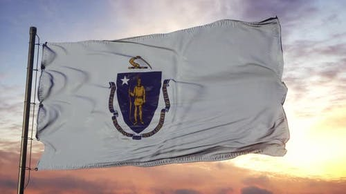 Flag of Massachusetts Waving in the Wind Against Deep Beautiful Sky at Sunset