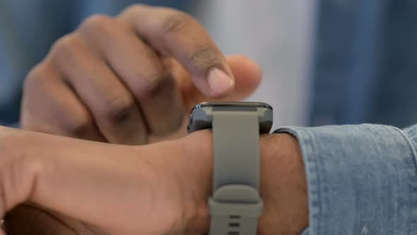 Thumbnail for Close Up of African Male Hands Using Smartwatch
