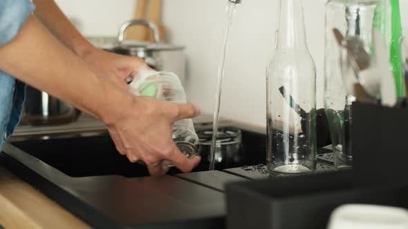 Thumbnail for Video of washing a glass jar. Shot with RED helium camera in 8K.