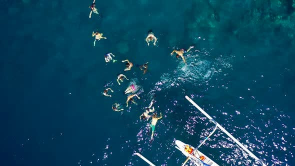 Thumbnail for Tourist People Snorkeling and Scubadiving in Azure Sea at the Jemeluk Bay, Amed Beach, Bali
