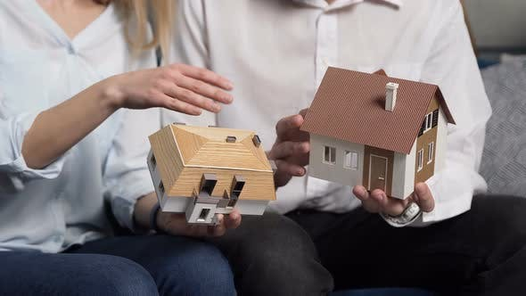 Thumbnail for Close Up Shof of 3d Model of Two House in the Man and Woman Hands.