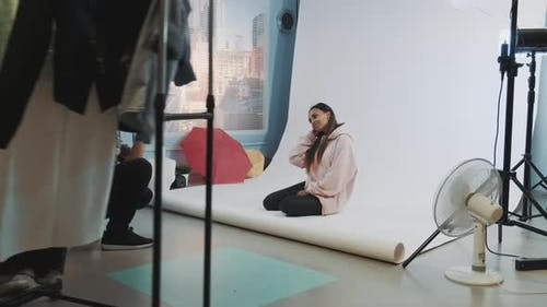 Behind the Scenes on Photo Session: Black Model Posing on the Floor for Fashion Magazine Photo Shoot