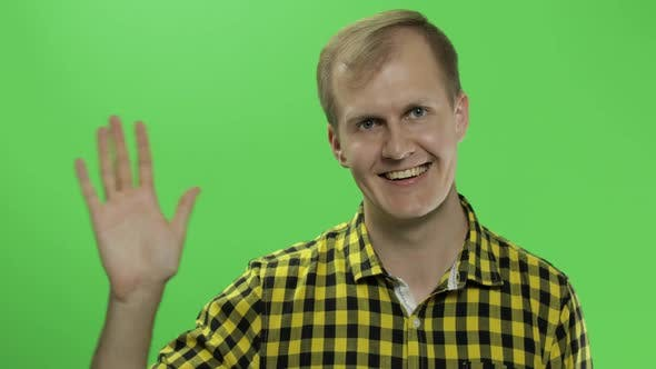 Thumbnail for Handsome Caucasian Man Waves and Saluting on Green Screen Chroma Key