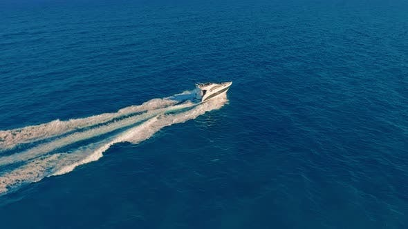 Thumbnail for Aerial View. A Powerboat Travelling Through the Water at High Speed.