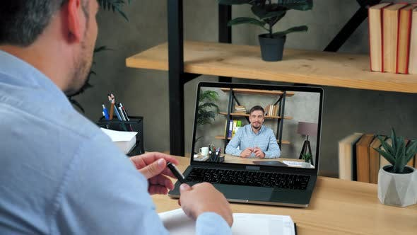 Businessman at Home Office Tells Top Manager Company Online Video Call Laptop