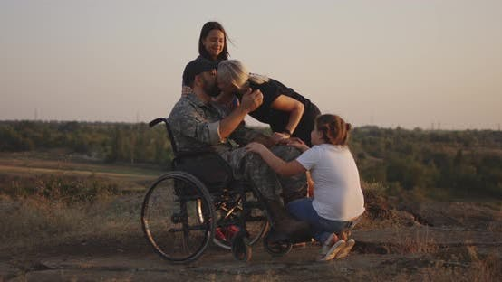 Thumbnail for Wheelchaired Soldier Being Together with Family