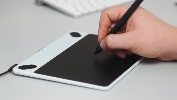 Designer Working With Graphic Tablet