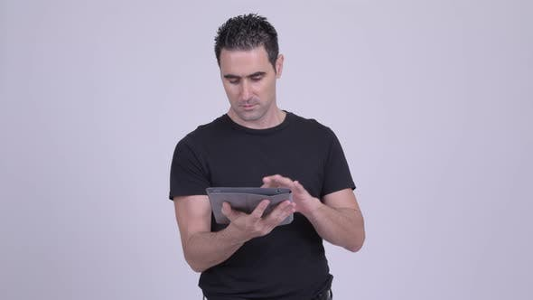 Cover Image for Happy Handsome Man Using Digital Tablet Against White Background