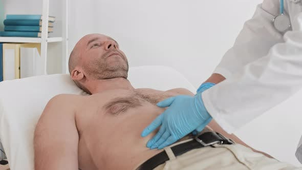 Thumbnail for Patient Lying on Examination Couch