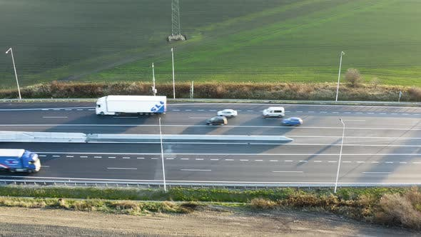Thumbnail for Aerial Shot of Highway with Cars During Sunny Day - Side Shot