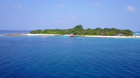 Thumbnail for Luxury fly over island view of a sandy white paradise beach and blue sea background in high resoluti