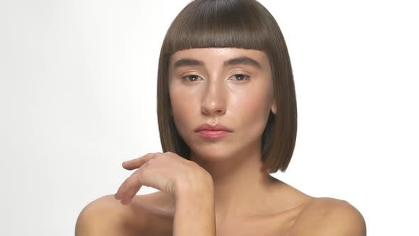 Lovely Female Model with Short Haircut and Bang Posing