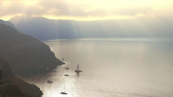Sun Rays Through Heavy Clouds Over the Caldera of Santorini
