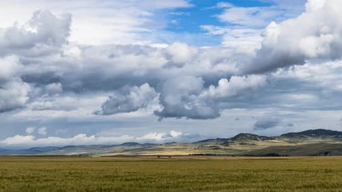 Stormy Clouds Over Farmland in Alberta Foothills  Timelapse
