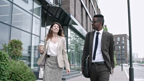 Thumbnail for African Businessman Walking on the Street with Female Colleague