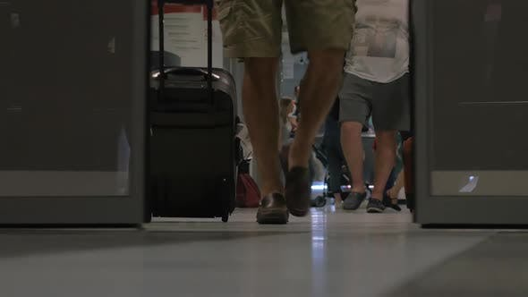 People walking out airport terminal