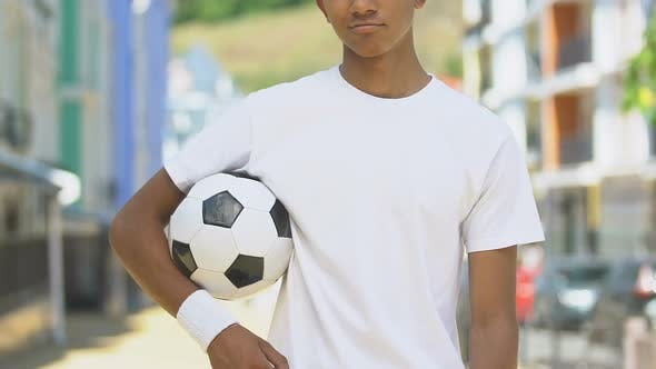 Thumbnail for Confident Sportsman Holding Soccer Ball