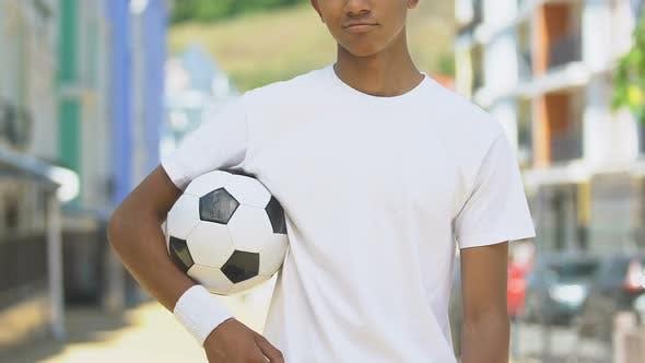 Confident Sportsman Holding Soccer Ball