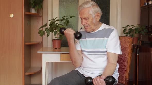 Thumbnail for Senior Elderly Caucasian Man Doing Weight Lifting Dumbbell Exercising at Home