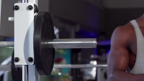 Thumbnail for African Man Putting Weight Plates on Barbell, Exercising at the Gym