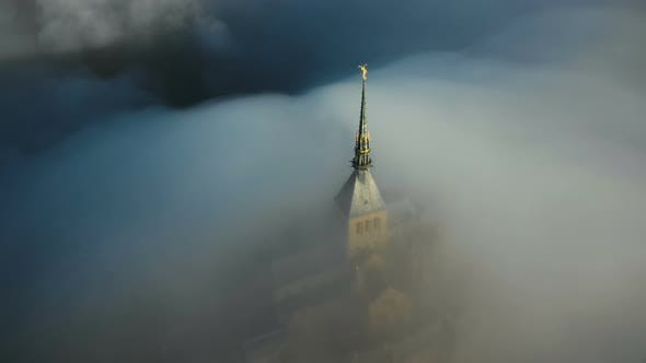 Thumbnail for Beautiful Aerial Shot of Thick Fog Covering Mystic Ancient Castle of Sunrise Mont Saint Michel at
