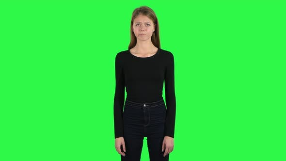 Young Woman Is Upset. Green Screen