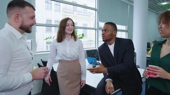 Business People Having Work Break in Coworking Space