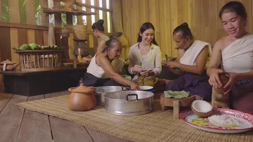 People Wearing Thai Traditional Costume Cooking In Traditional Common Thai Kitchen
