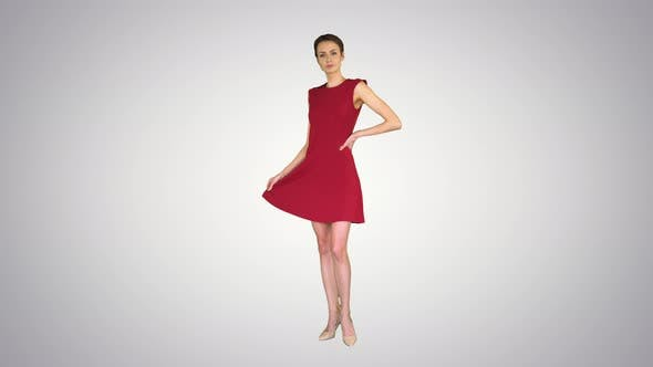 Thumbnail for Beautiful Young Woman with Short Hair in Red Dress Posing on Gradient Background.