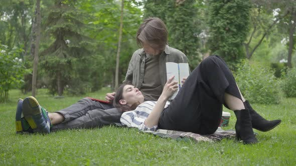 Thumbnail for Young Couple in Casual Clothes Spending Time Together Outdoors, Having Date