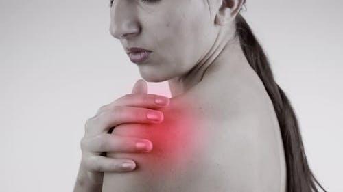Shoulder Pain. Woman Rubbing Shoulder