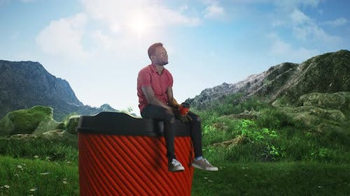 Black Man Drinking Coffee on Huge Cup in Nature