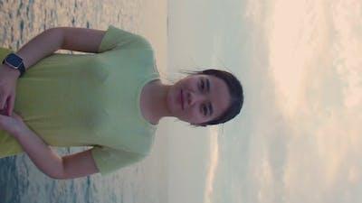 Vertical video: Smiling of portrait woman wearing sportswear.