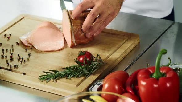 Thumbnail for Chef Hands Cutting Meat with Knife. Chef Hands Slicing Hum in Slow Motion.