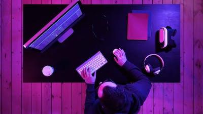 Hacker at the computer hacking.